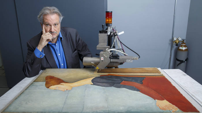 Art historian Marc Restellini with an X-ray machine and an authentic Modigliani